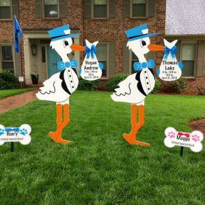 storks with dog bone sibling signs